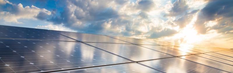 Sunrise on Solar Panels Photo
